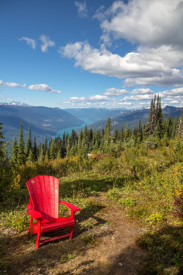 Inviting Canada National Parks` red chair, Mount Revelstoke National Park stock photography