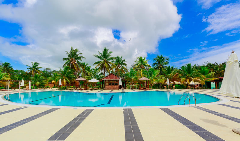 Inviting gorgeous, stunning view of hotel grounds with cozy, comfortable swimming pool royalty free stock photography