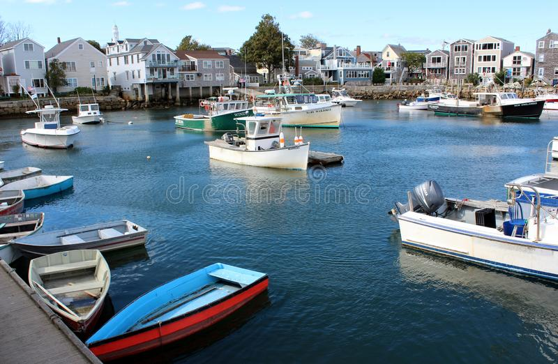 Inviting historic seaside town with quaint facade of shops and all types of colorful boats, Rockport Mass, 2018 stock photography