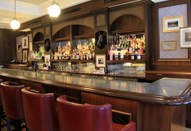 Download Beautiful Seating At Long Wood Bar With Well Stocked Cabinets,  Morrissey`s