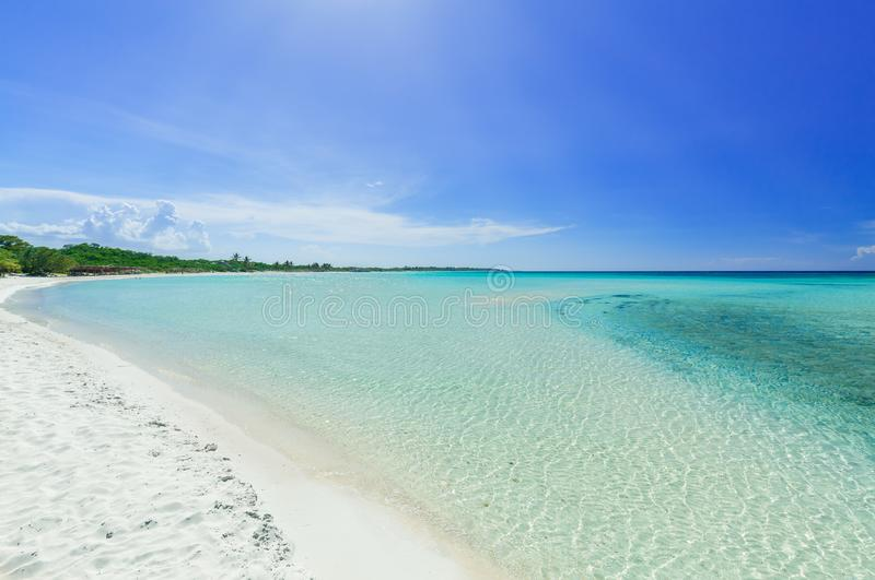 inviting view of tropical white sand beach and tranquil turquoise ocean on blue sky background at Cayo Coco Cuban island stock images