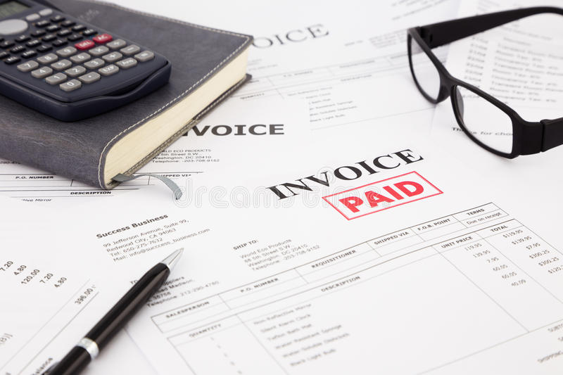 Invoice and bills with paid stamp royalty free stock images