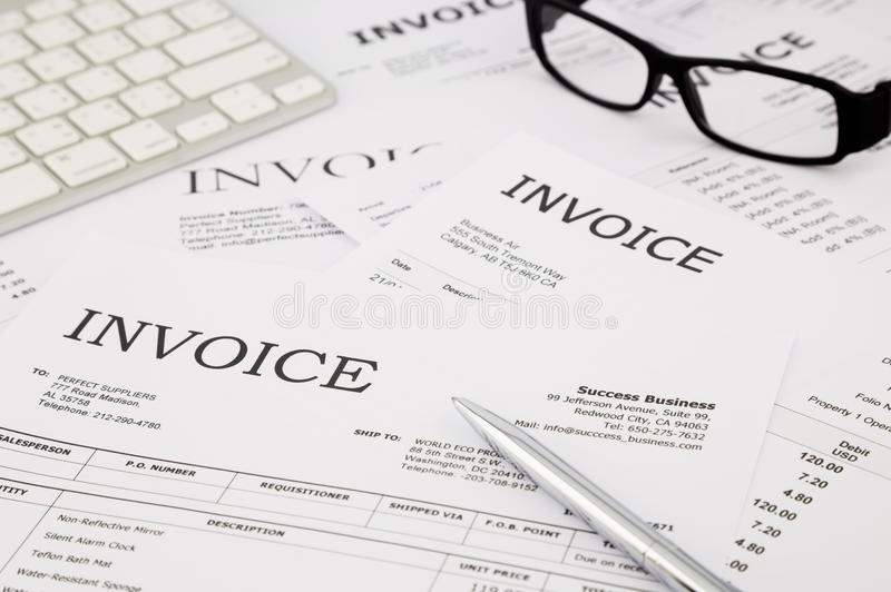 Invoices and bills on office table royalty free stock photo