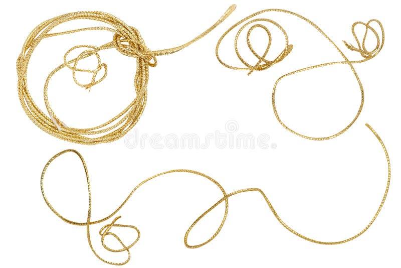 Involucro dorato della corda isolato su bianco fotografia stock