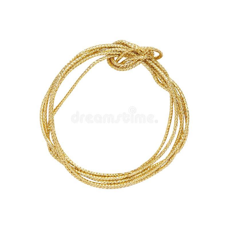 Involucro dorato della corda isolato su bianco immagine stock