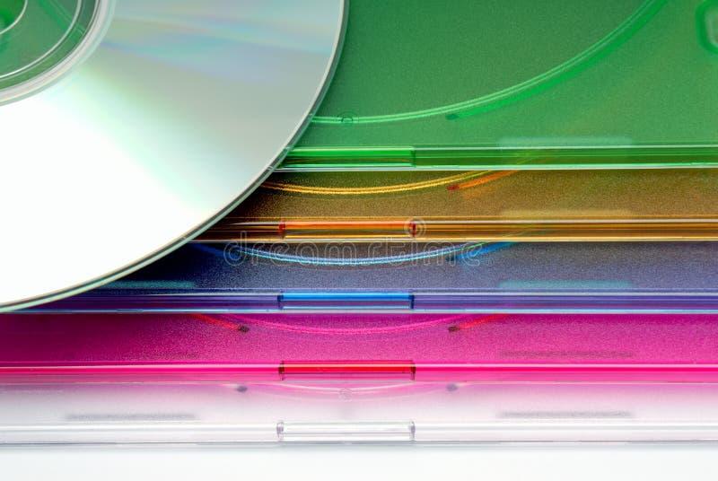 Inzameling die als achtergrond - een doos voor CD van een schijf in dozen doen stock foto