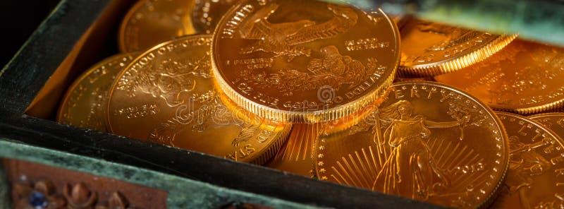 Inzameling van één ons gouden muntstukken stock afbeelding