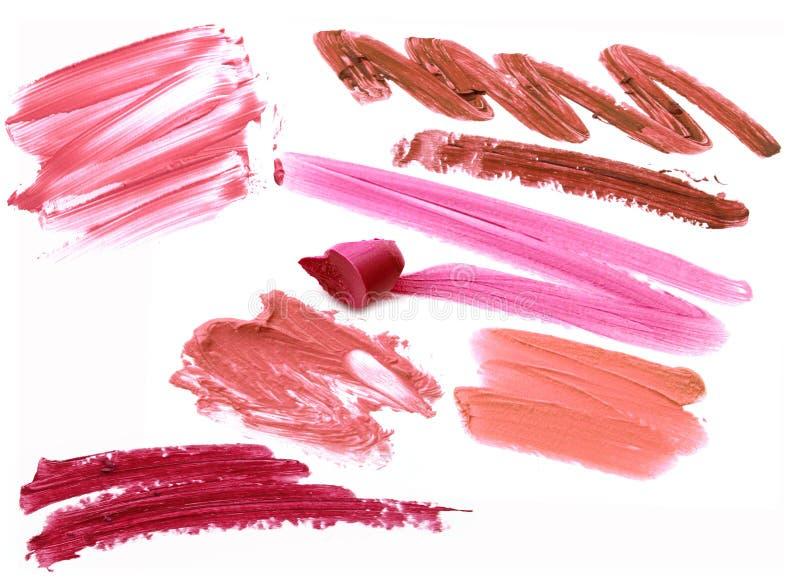 Inzameling van bevlekte die lippenstiften op wit wordt geïsoleerd royalty-vrije stock afbeelding