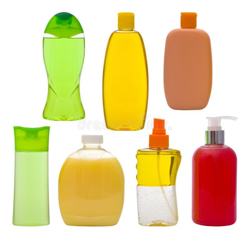 Inzameling van geïsoleerde shampooflessen en zeepautomaten stock afbeelding