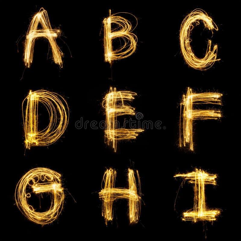 Inzameling van het lichte alfabet van het sterretjevuurwerk vector illustratie