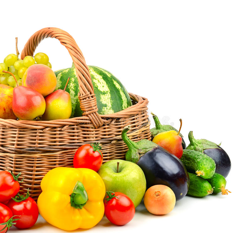 Inzamelingsfruit en groente in mand stock afbeelding