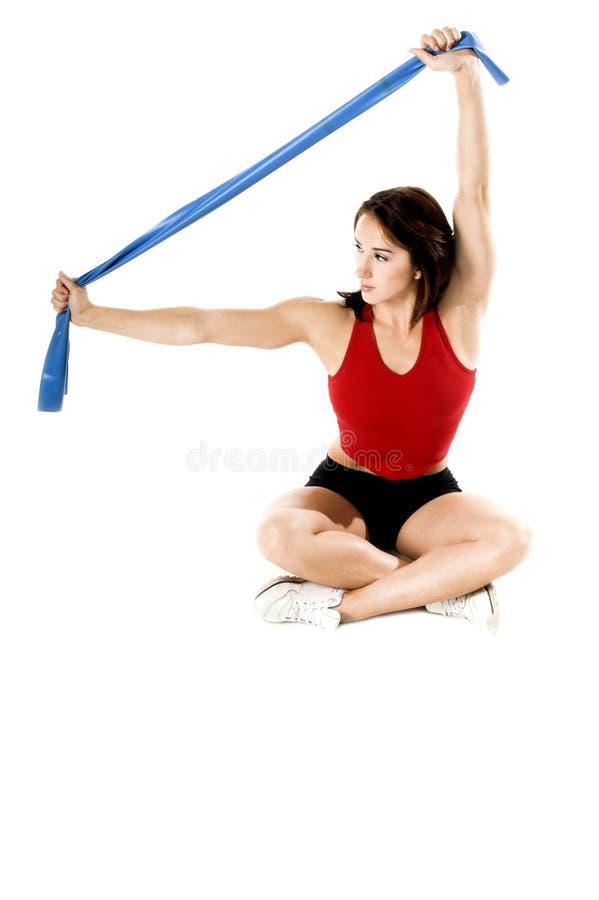 A ioga da faixa do estiramento elabora fotos de stock