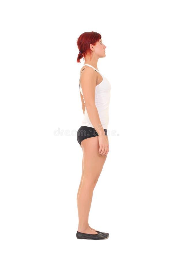 Ioga do treinamento da jovem mulher foto de stock