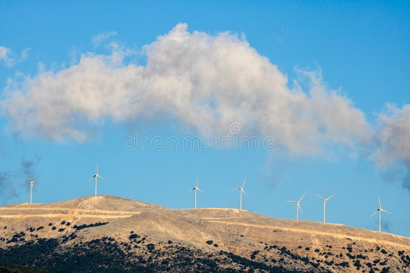 Wind turbines in the mountains of Greek island Kefalonia. Ionian coast in Greece is ideal as a source of renewable energy because of the strong northwest wind royalty free stock photography