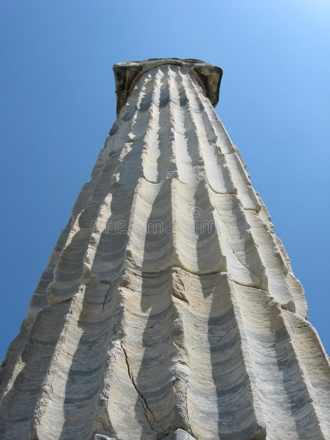 Ionic column against blue sky, ancient city Priene, Turkey royalty free stock photo