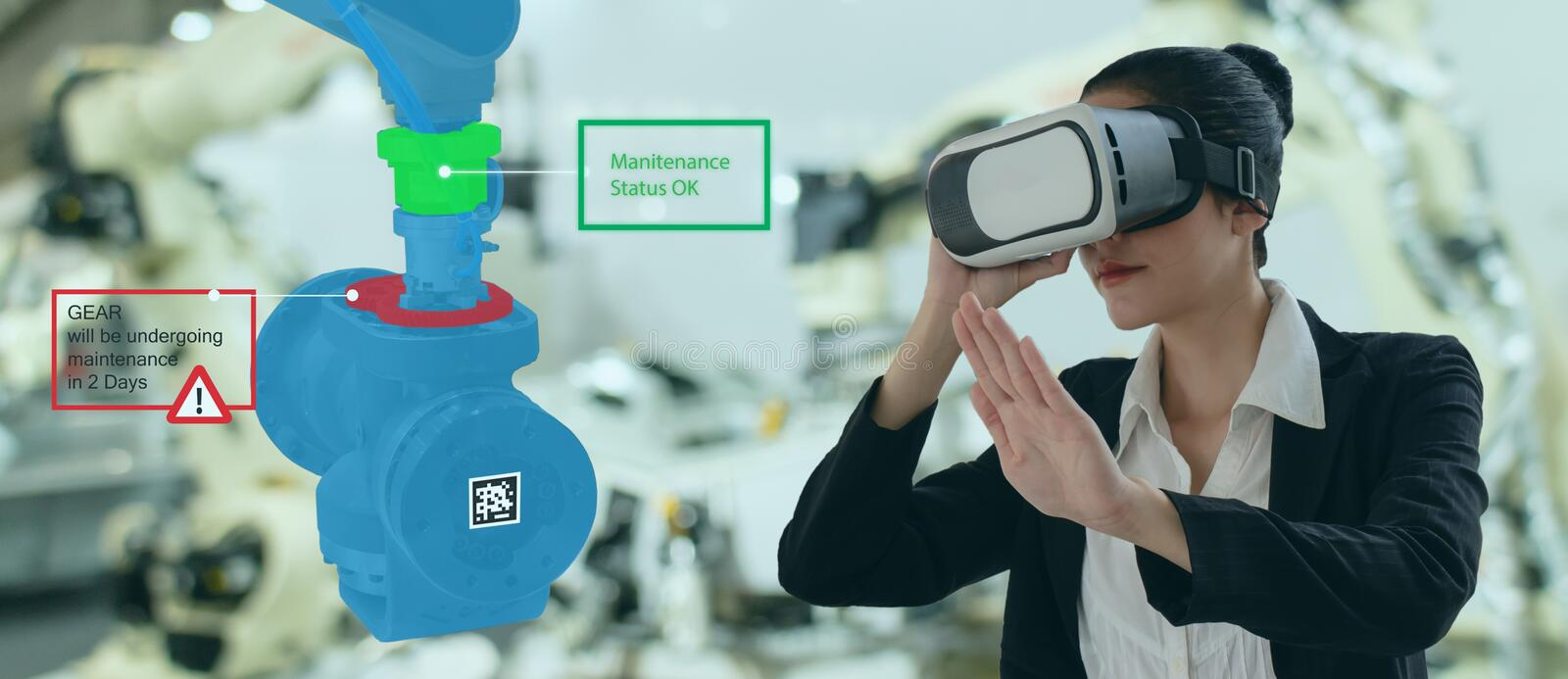 Iot industry 4.0 concept,industrial engineer using smart glasses with augmented mixed with virtual reality technology to monitorin royalty free stock photo