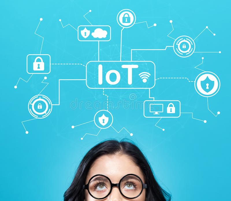 IoT security theme with young woman. On a blue background stock photos