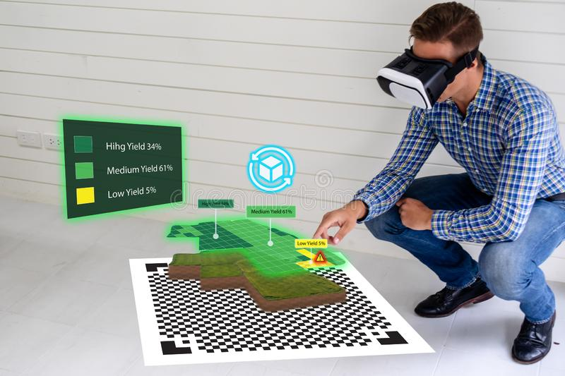 Iot smart industry 4.0 agriculture concept,agronomist,farmer using smart glasses augmented mixed virtual reality,artificial intel royalty free stock image
