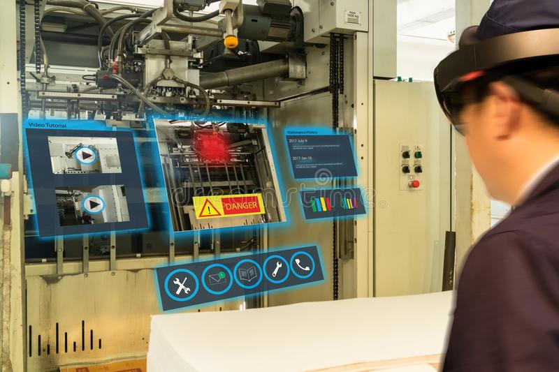 Iot smart industry 4.0 concept. Industrial engineerblurred using smart glasses with augmented mixed virtual reality technology t. O read the data that how to fix stock photography