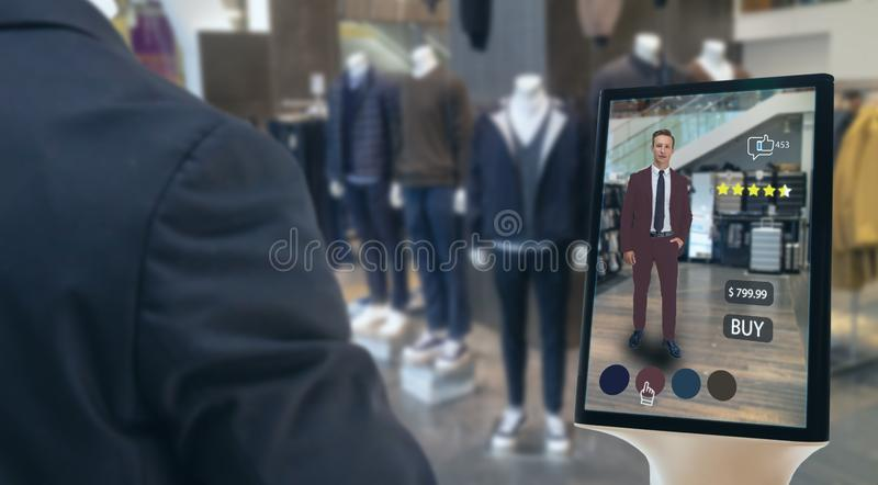 Iot smart retail futuristic technology concept, happy man try to use smart display with virtual or augmented reality in the shop o royalty free stock image