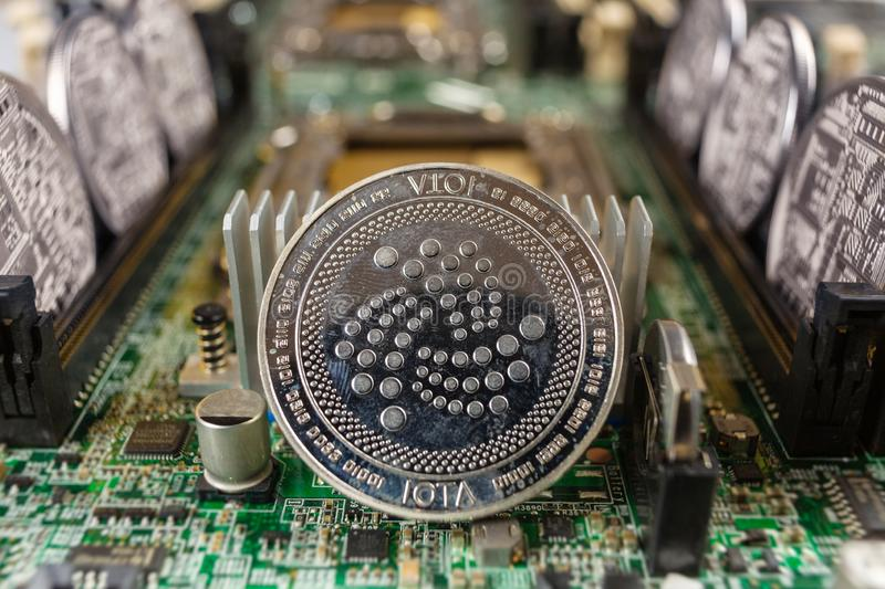 IOTA coin on a technology circuit royalty free stock images