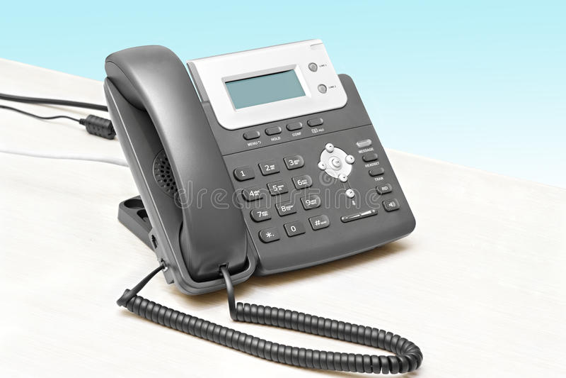 IP telefoon met een vertoningslijst stock fotografie