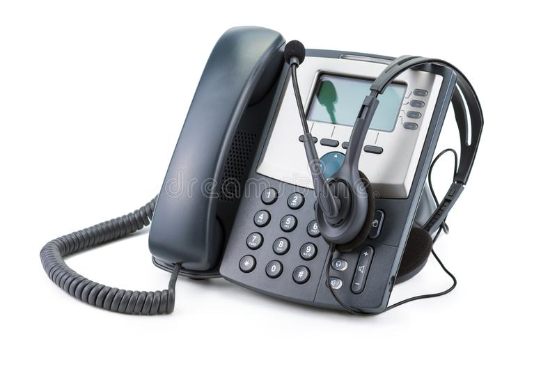 IP Telephone device with headset isolated on white royalty free stock photos