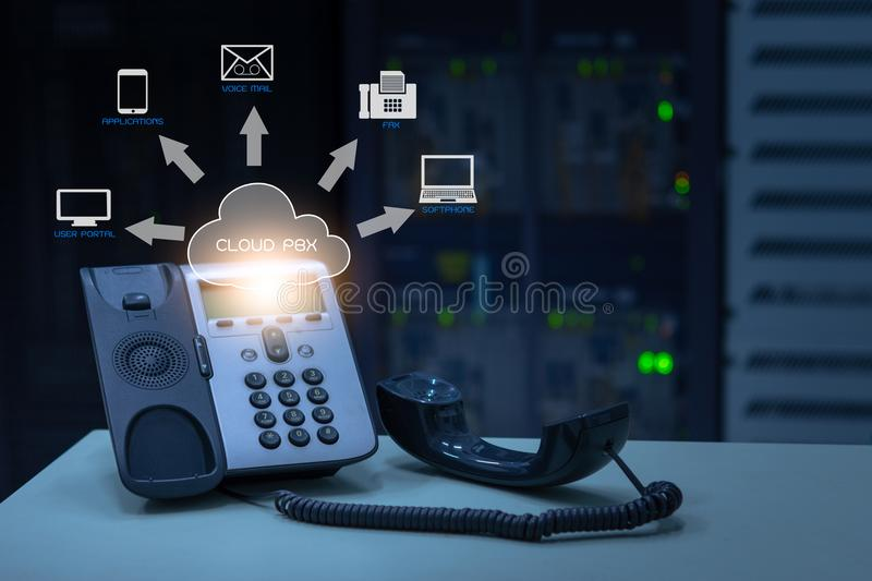 IP Telephony cloud pbx concept, telephone device with illustration icon of voip services stock photos