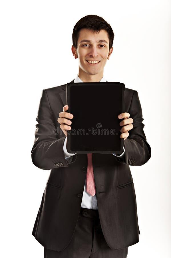 ipad удерживания бизнесмена стоковая фотография