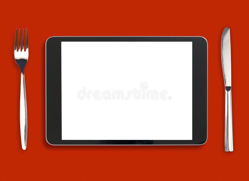 Ipad na tabela vermelha com forquilha e faca fotos de stock