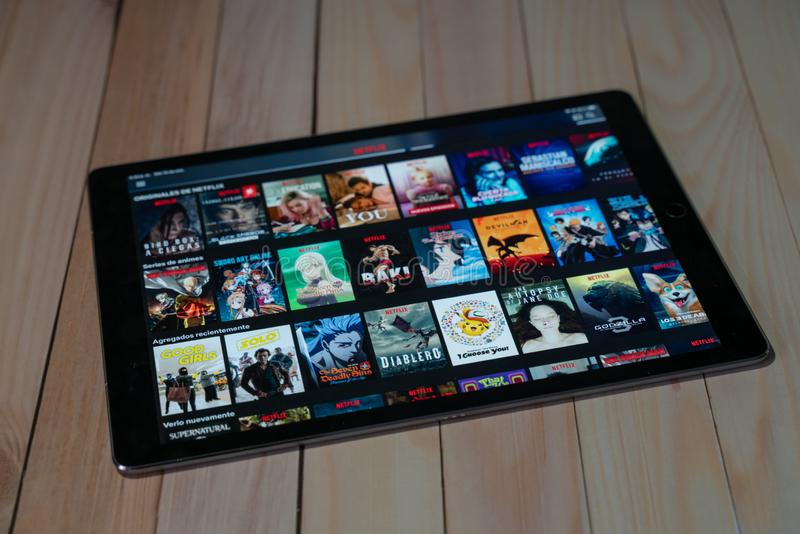 IPad Pro12.9 tablet new product of apple using Netflix, Netflix is a global provider of streaming movies and TV series royalty free stock photo