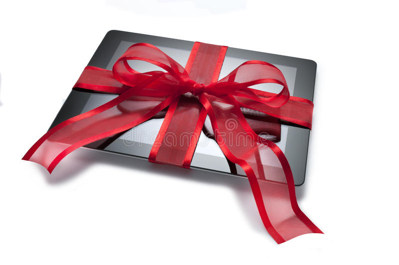 Ipad Tablet Christmas Present Gift. An ipad tablet Christmas present with a red bow on a white background