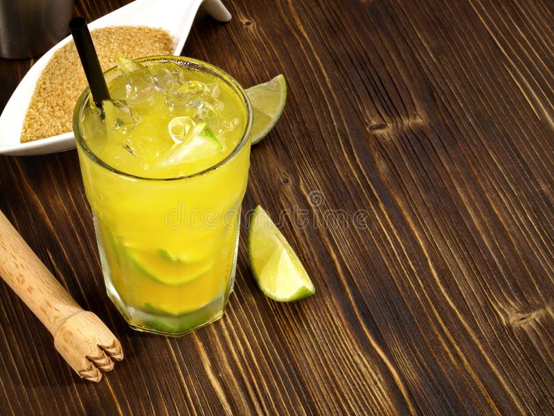 Ipanema - Non alcoholic Cocktail with brown Sugar. Ipanema - Non alcoholic Cocktail on a wooden Table royalty free stock image