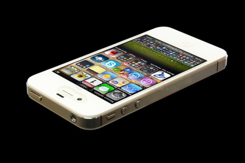 IPhone 4 aislado en fondo negro imagen de archivo