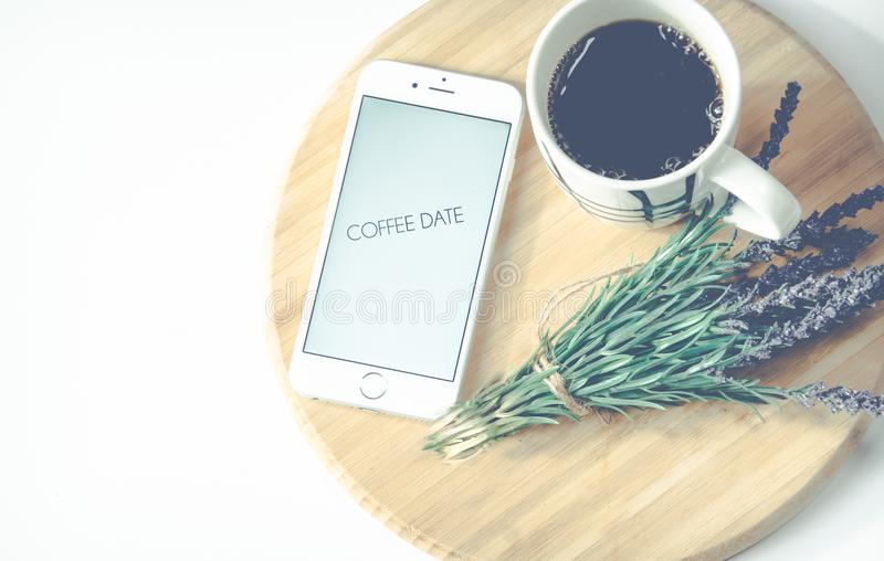 Iphone Beside Coffee And Flower stock photo