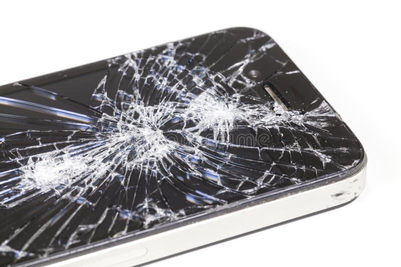 IPhone 4 com a tela de exposição seriamente quebrada da retina foto de stock