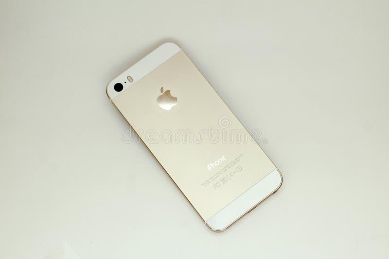 IPhone de Apple da cor da cor do ouro fotografia de stock