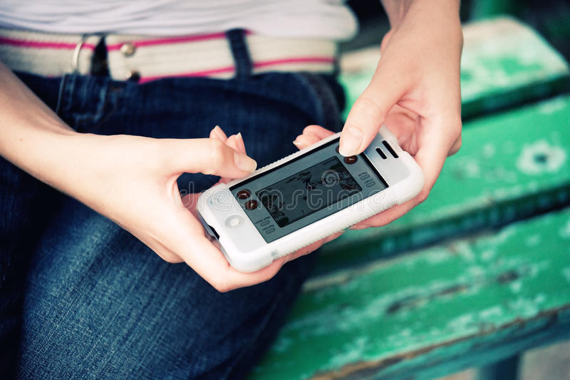 Download Iphone game stock image. Image of held, game, small, electronic - 25912559