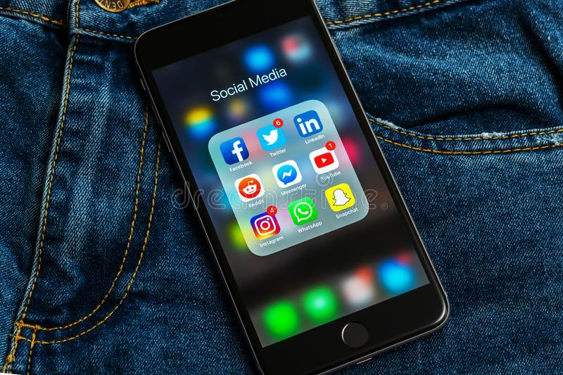 IPhone with icons of social media: instagram, youtube, reddit, facebook, twitter, snapchat, whatsapp applications on screen stock image