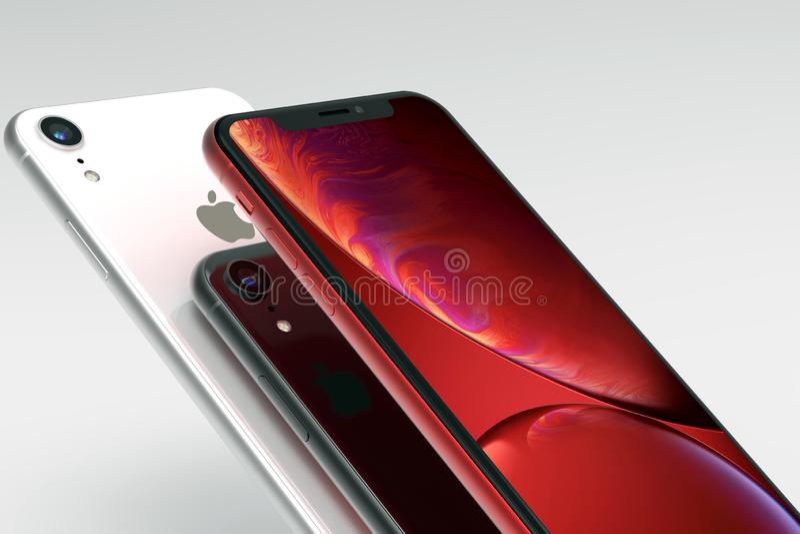 3 iPhone Rote, silberne und des Raumes graue intelligente Telefone XR auf Weiß lizenzfreie abbildung