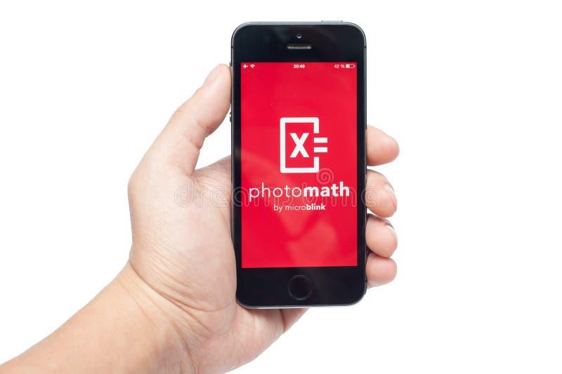 IPhone 5s med PhotoMath app arkivfoto