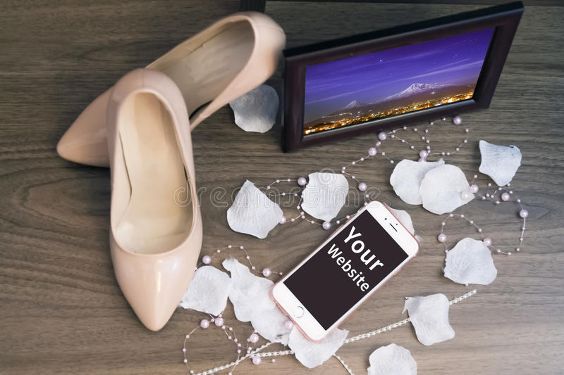 My wedding day photo frame shoes and iphone blank screen. Iphone with photo frame s women shoes stock photography