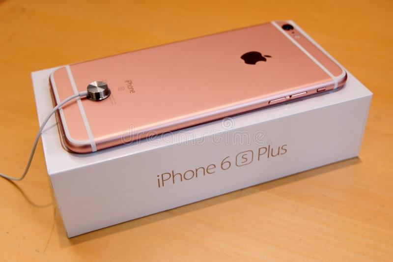 IPhone 6S Plus Rose Gold Face Down on Retail Box. Apple's newest flagship iPhone 6S Plus in the newly introduced color, Rose Gold on top of retail box stock images