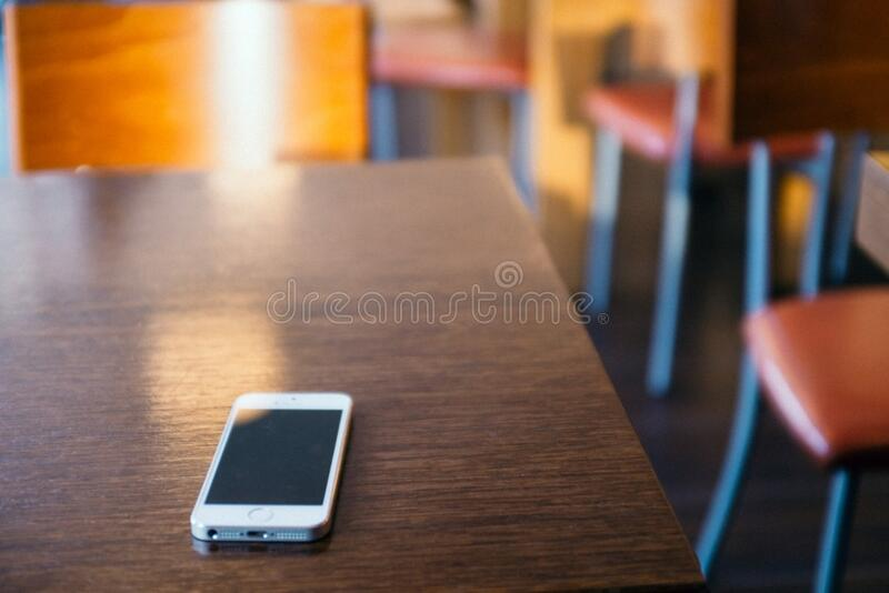iPhone 5s on table royalty free stock photography