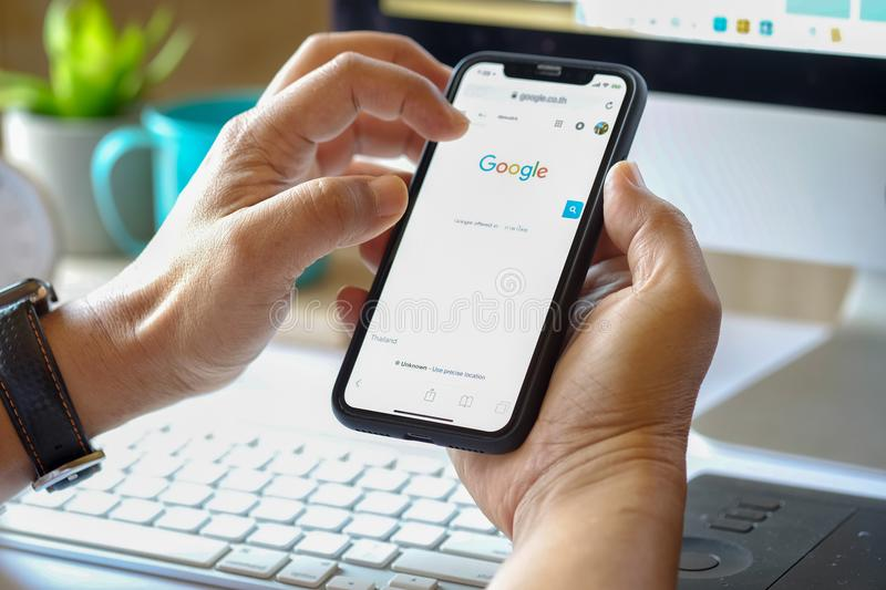 IPhone X showing Google app. Google is an American multinational corporation specializing in Internet-related services. Most of i. CHIANG MAI,THAILAND MARCH 5 royalty free stock photos