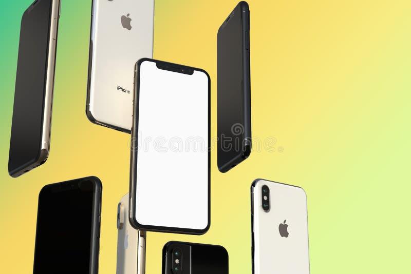 IPhone XS金、银和空间灰色智能手机,漂浮在空气,白色屏幕 库存照片