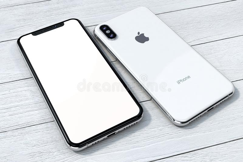 IPhone Xs银在白色木头的大模型构成 免版税库存图片