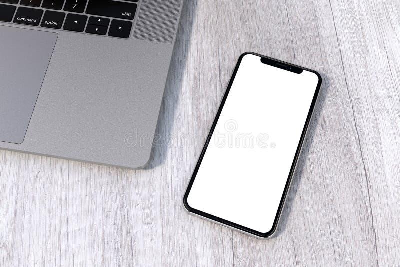 IPhone Xs银样式智能手机在桌上的大模型透视 免版税库存图片