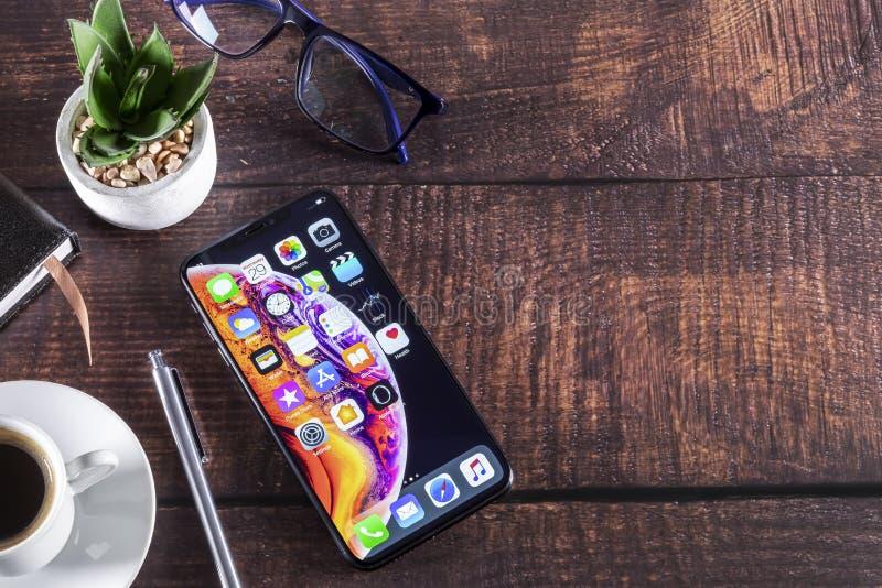 IPhone XS on luxury furniture wooden. Galati, Romania- May 29, 2019: Apple Computers iPhone XS on luxury furniture wooden - smartphone telephone with OLED royalty free stock photography
