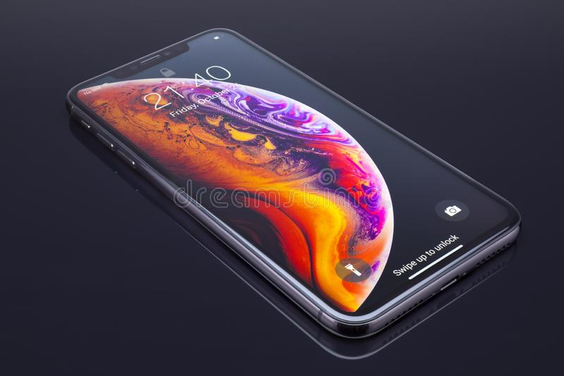 IPhone Xs Max on black glass stock images